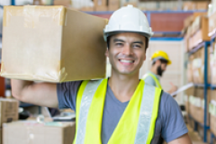 man in warehouse holding a box