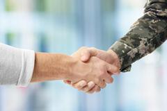 Military handshake with Civilian